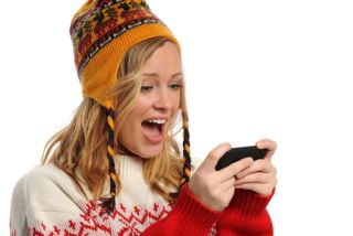 Girl texting in the cold