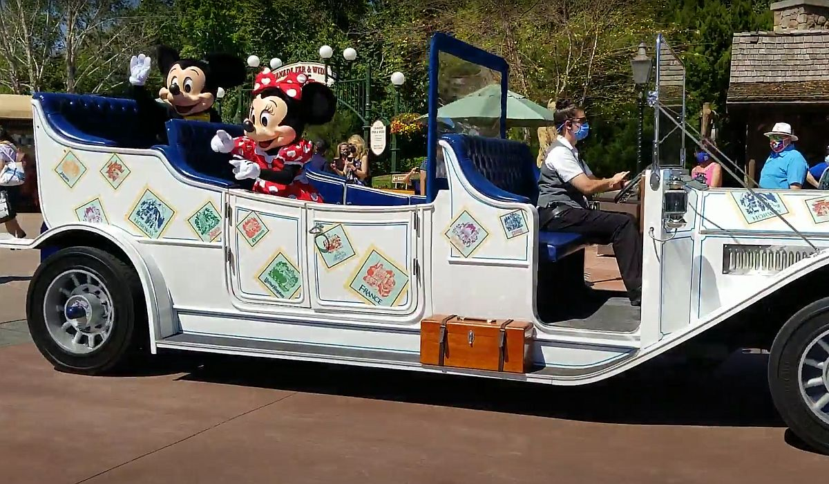 Mickey and Minnie riding in a car at Epcot