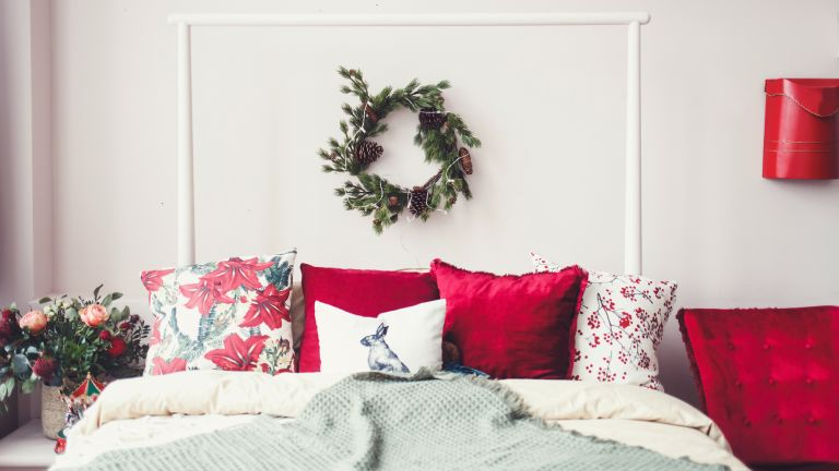 a christmas bedroom with christmas bedding