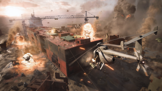Battlefield 2042 helicopter flying over a building site that is on fire