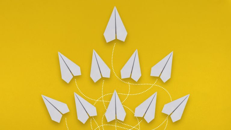 travel green list, Paper Airplanes Multiple Flight Direction Concept on Yellow Background