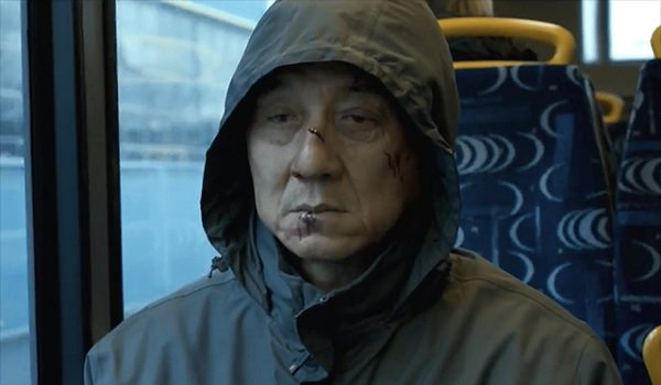 The Foreigner Jackie Chan taking the bus with a beat up face