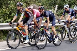 Jack Haig of Bahrain Victorious on stage 10 in front of Adam Yates (Ineos Grenadiers)