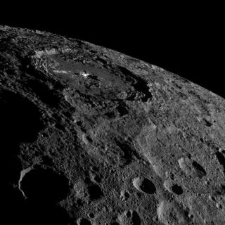 The strange bright spots of Occator Crater on the dwarf planet Ceres are unmistakable in this spectacular photo by NASA's Dawn spacecraft taken on Oct. 17, 2016 and released on Nov. 18 as Dawn moves into a higher orbit.