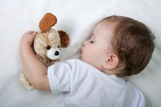 A child sleeping peacefully in a crib.