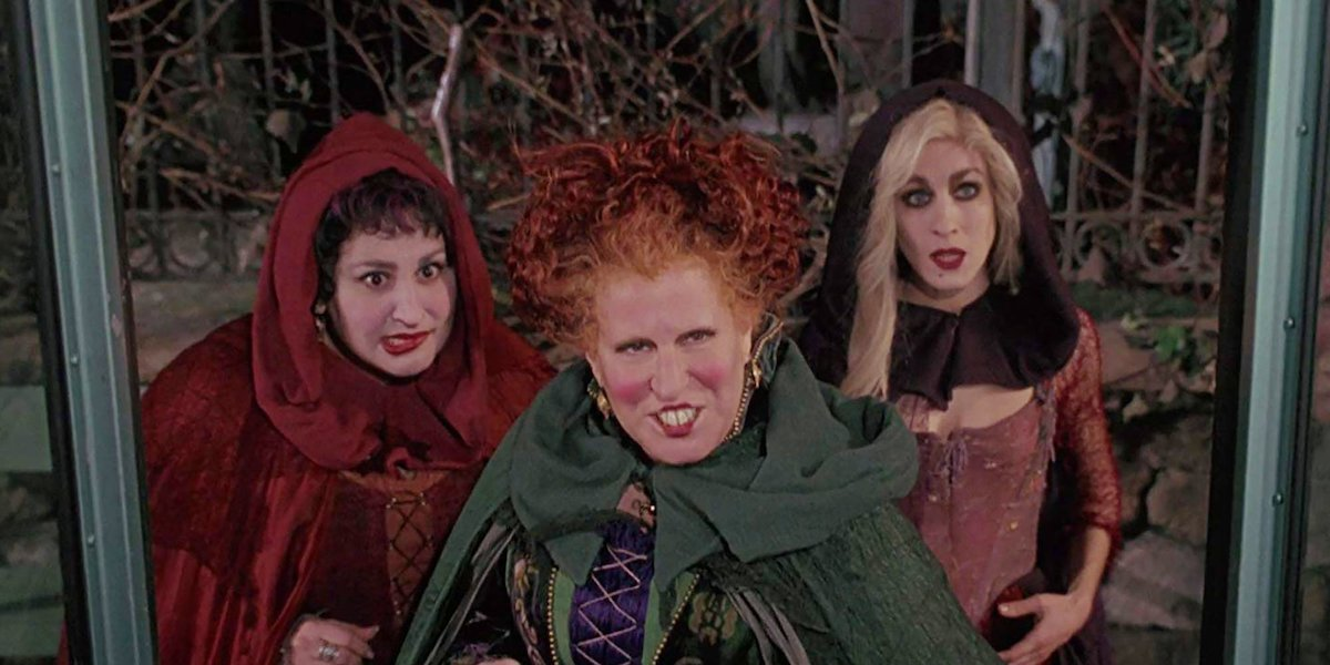 The Sanderson Sisters wait to board a bus in a scene from 'Hocus Pocus'
