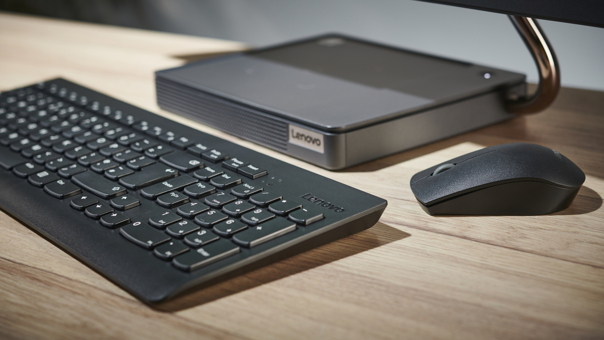 Lenovo IdeaCentre AIO 5 all-in-one PC on a desk in an office close up of keyboard and mouse