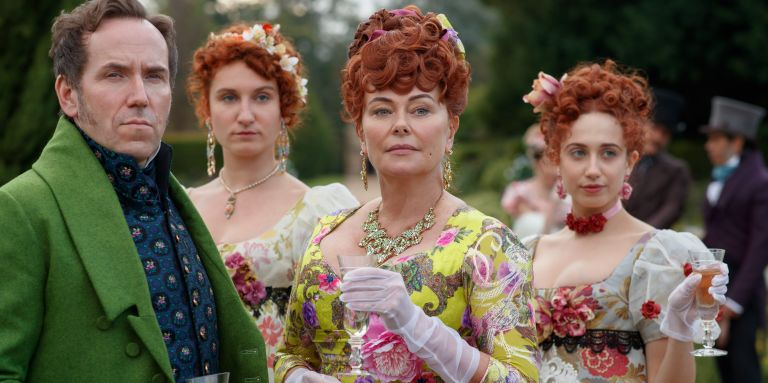 BRIDGERTON (L to R) BEN MILLER as LORD FEATHERINGTON, BESSIE CARTER as PRUDENCE FEATHERINGTON, POLLY WALKER as PORTIA FEATHERINGTON and HARRIET CAINS as PHILLIPA FEATHERINGTON in episode 106 of BRIDGERTON