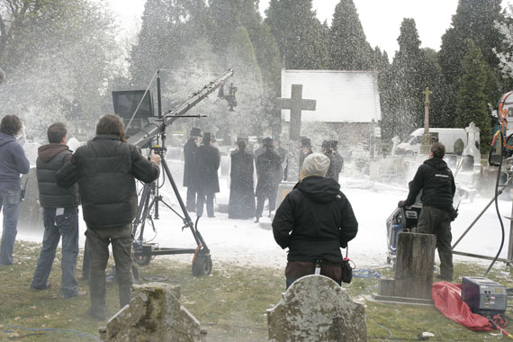 The machines blow fake snow in a burial scene
