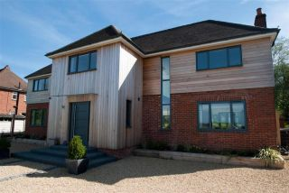 brick and wood clad remodelled house