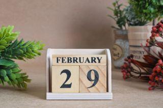 February 29 on a wooden calendar.