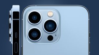 The iPhone 13 Pro's camera module on a blue background