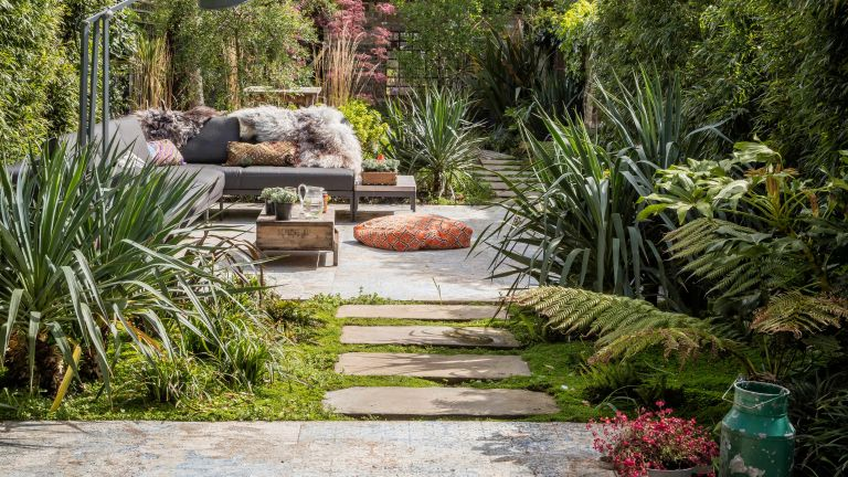 Garden with patio, outdoor sofa and modern flower bed ideas