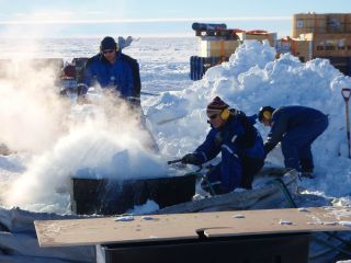 Researchers use hot water to drill through the thick Fimbul Ice Shelf in eastern Antarctica.