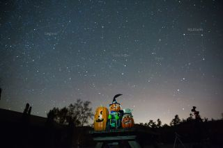 Star trails swirl over three smiling jack-o'-lanterns in this night-sky photo by amateur astronomer Gowrishankar L.