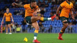 Australia's Quade Cooper kicks a rugby conversion