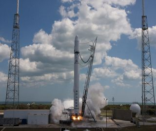 Falcon 9 rocket successfully test fires nine engine first stage.