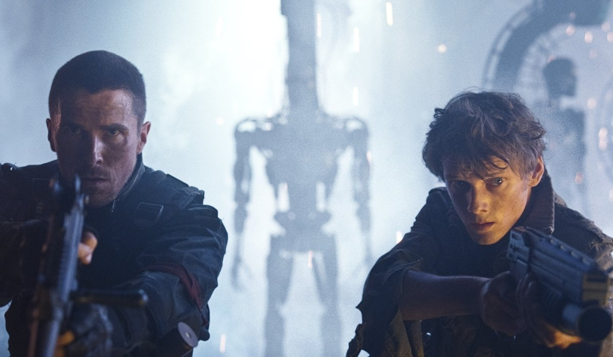 Terminator: Salvation John Connor and Kyle Reese aiming guns in a robot factory