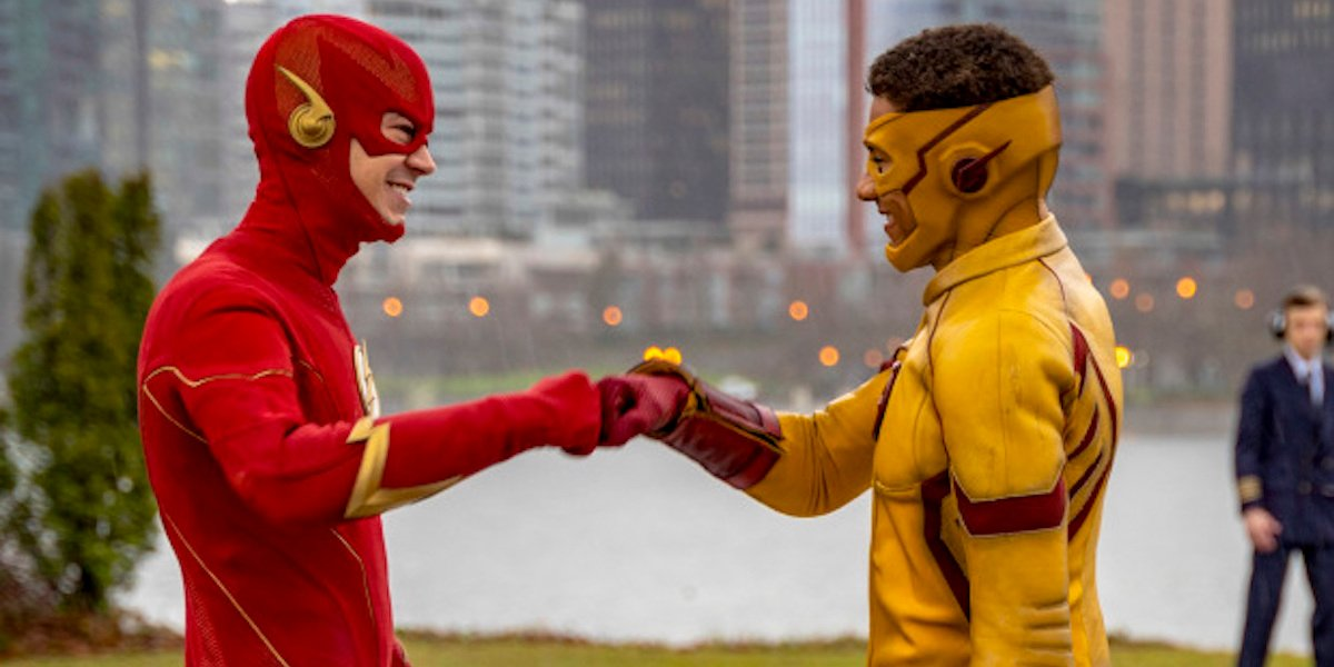 Grant Gustin and Keiynan Lonsdale as Flash and Kid Flash fist bumping in CW's The Flash