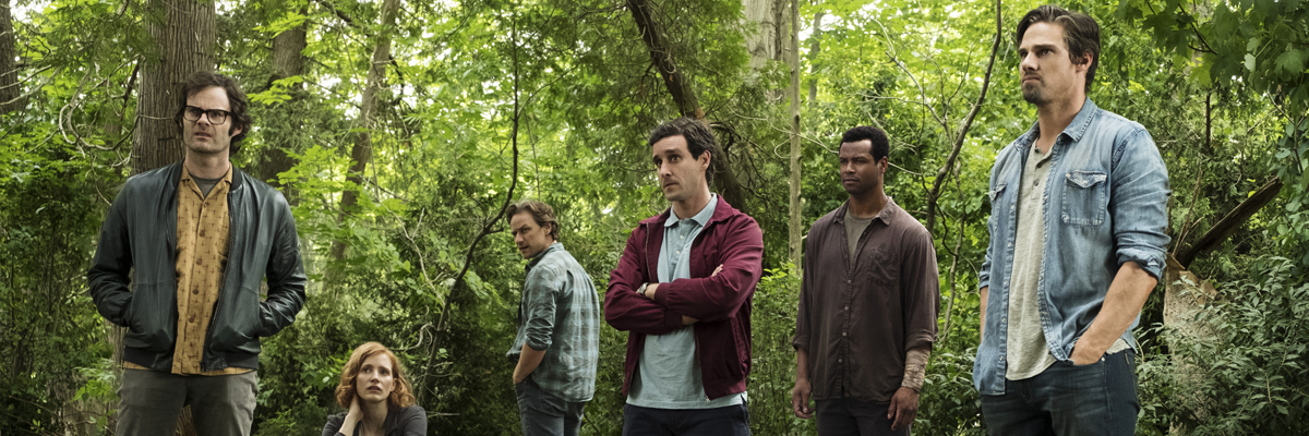 Adult Losers Club standing in the woods in IT CHapter 2