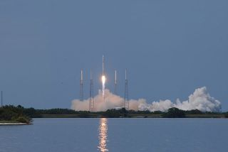 The commercially backed Falcon 9 lifts off from Cape Canaveral.