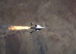 This screenshot from a Virgin Galactic video shows the company's VSS Unity vehicle firing up its rocket motor during its third test flight to suborbital space, on May 22, 2021.