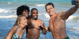 Meredith Hagner, Yvonne Orji, Lil' Rel Howery, and John Cena pose for a selfie on the beach in Vacation Friends.