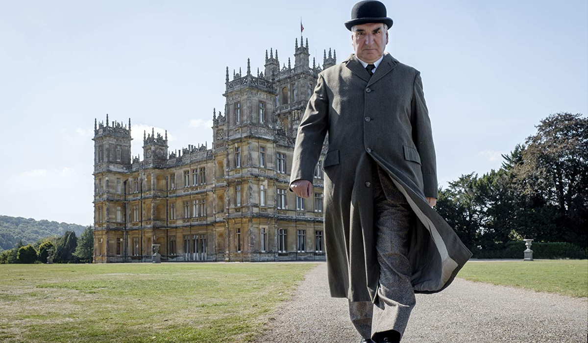 Downton Abbey Carson walks down the path from Downton