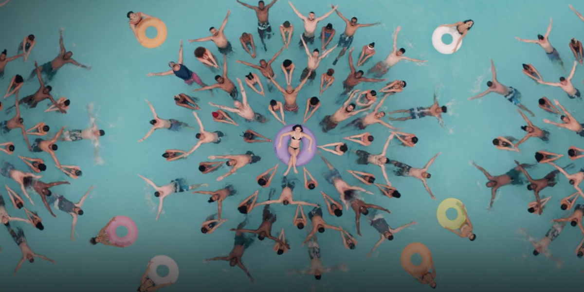 In the Heights 96,000 pool scene with Vanessa surrounded by synchronized swimmer dancers