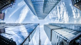 Best cloud storage: Glass buildings rise to meet the clouds in the sky