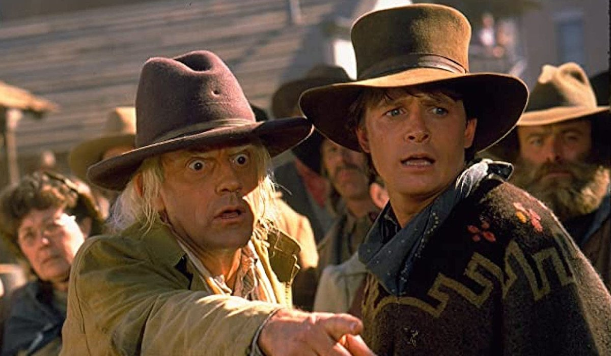 Christopher Lloyd points out something shocking to Michael J. Fox in Back To The Future: Part III.