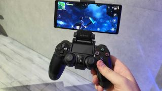 A DualShock 4 controller with a phone attached via phone stand