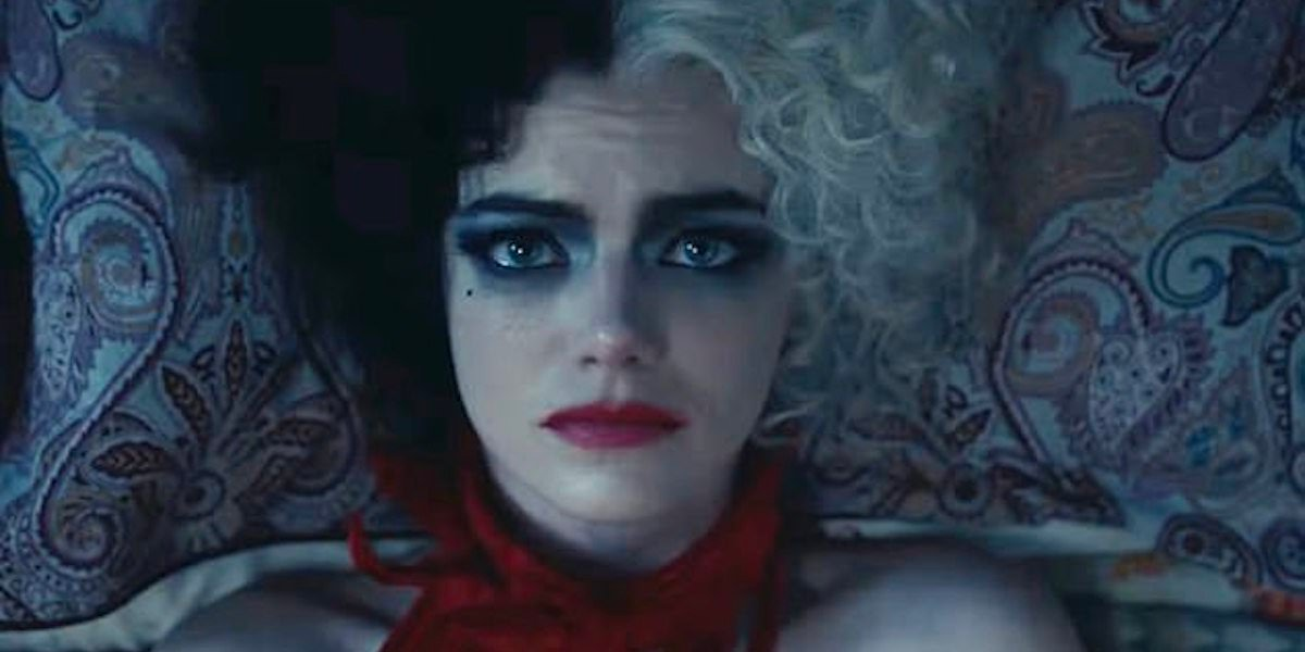 Emma Stone as Cruella de vil laying in bed 2021 live-action origin story