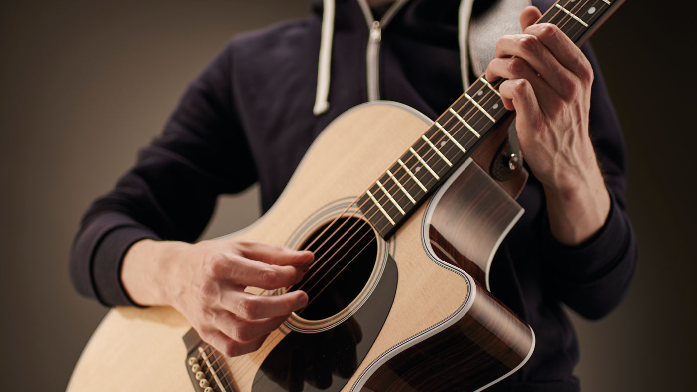 Your first acoustic guitar lesson