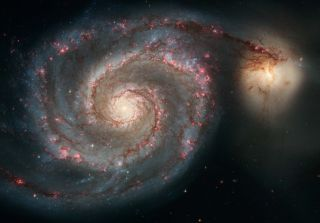 An image of the spiral galaxy M51 captured by the Hubble Space Telescope