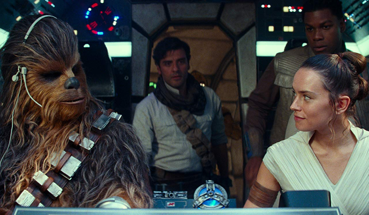 Star Wars: The Rise of Skywalker Chewie, Poe, Finn, and Rey in the cockpit of the Millennium Falcon