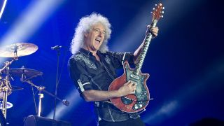 A photograph of Brian May on stage playing guitar in 2016
