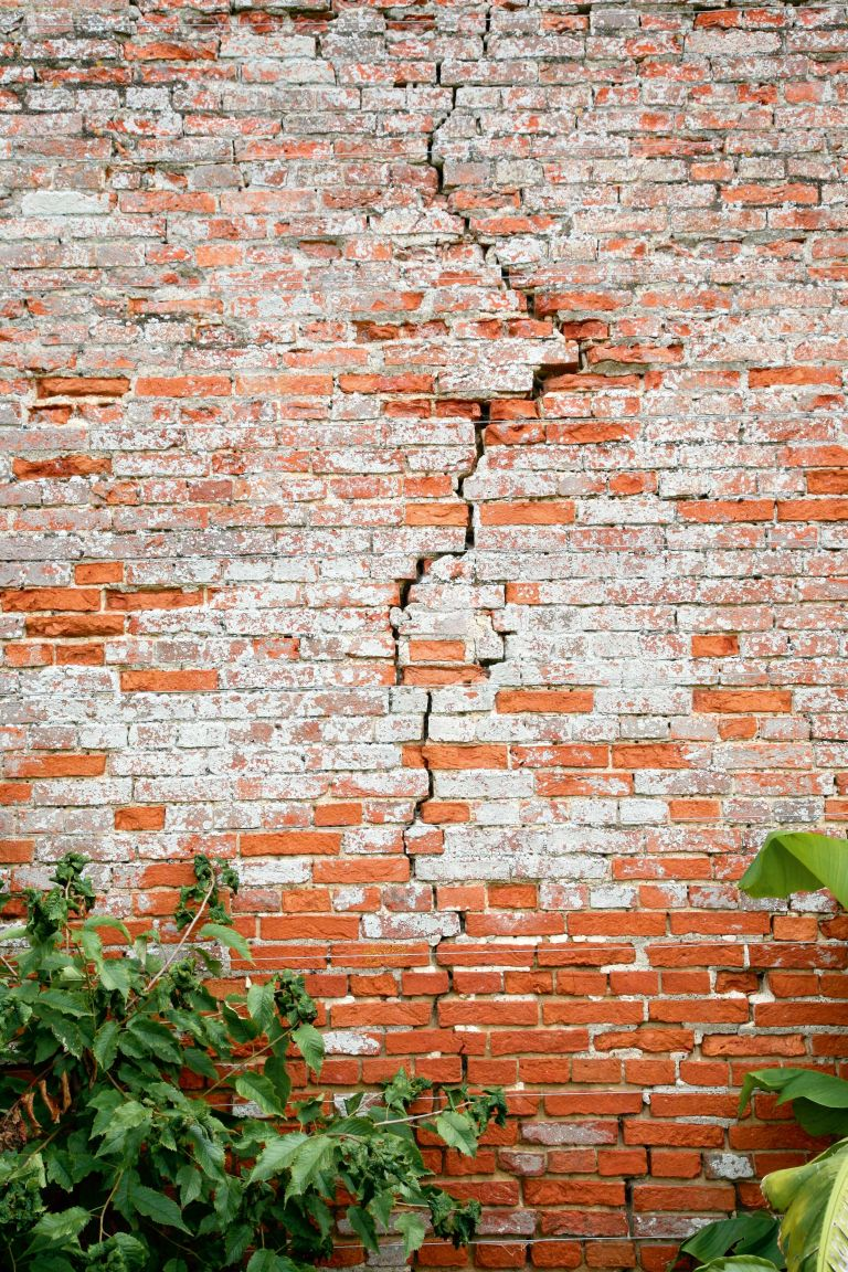 Cracked exterior brick wall