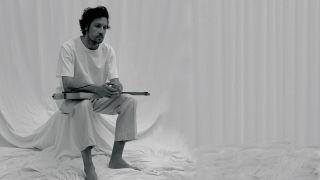 Plini in a white room