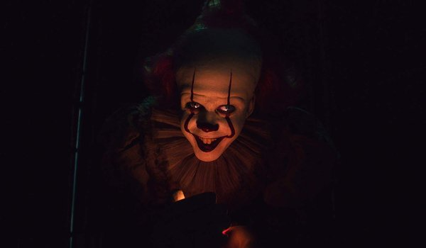 IT: Chapter 2 Pennywise luring a kid into the darkness at the fair