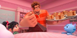 Ralph and Vanellope feed pancakes to a cat in Ralph Breaks the Internet