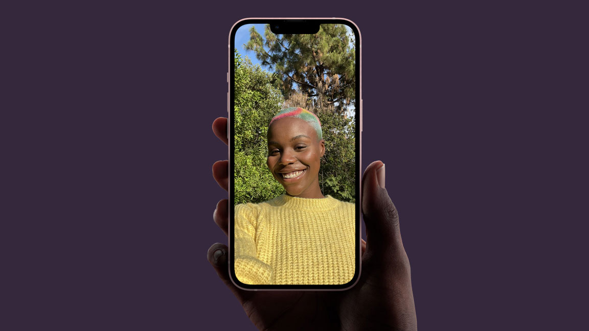 Phone being held in hand while user takes selfie