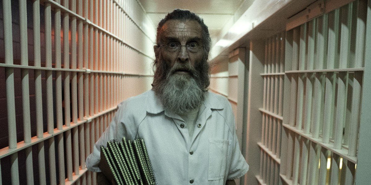 john glover's teddy in jail with his notebooks on fear the walking dead season 6