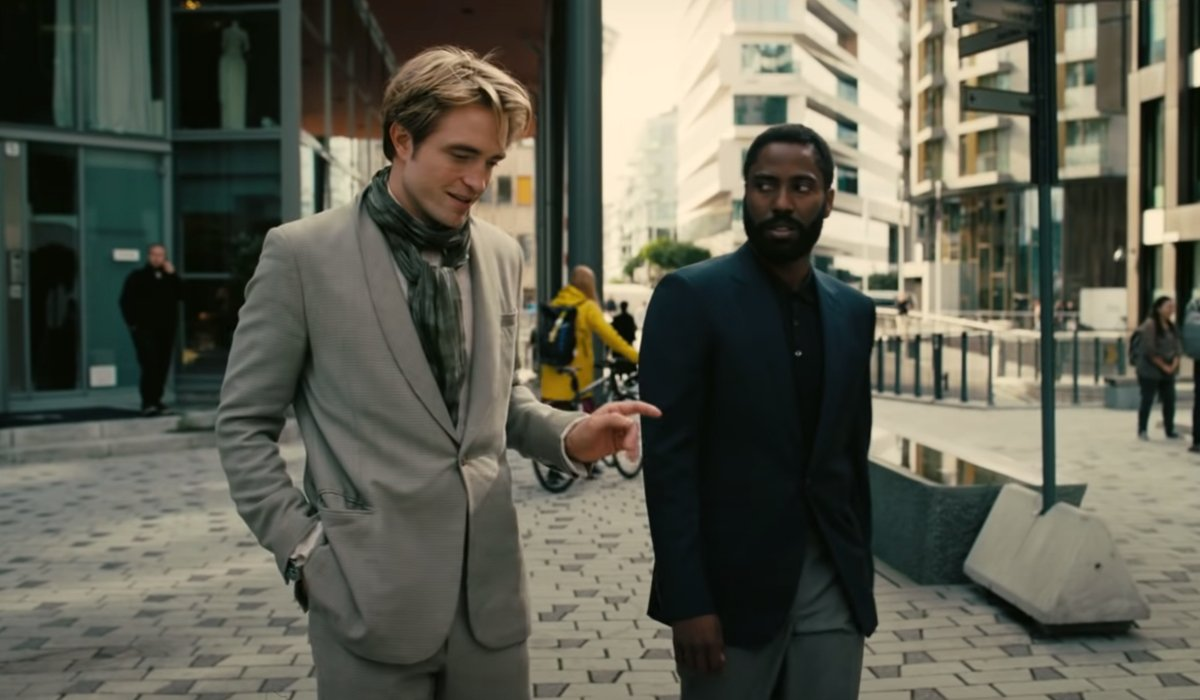 Tenet Robert Pattinson explains a point to John David Washington