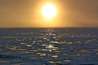 The sun sits low on the Arctic horizon during the NASA-sponsored ICESCAPE mission of 2011 as scientists on board the U.S. Coast Guard Cutter Healy headed south in the Chukchi Sea.