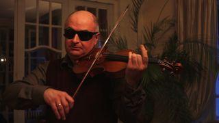 soloist doing blind violin test
