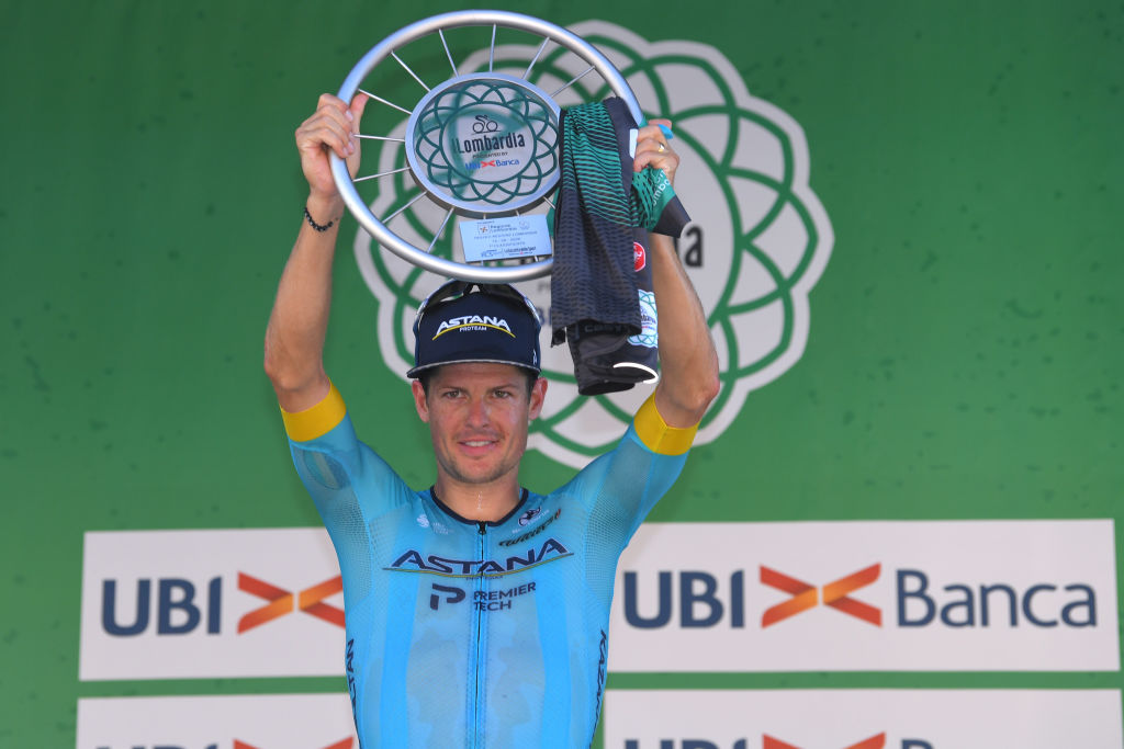 COMO ITALY AUGUST 15 Podium Jakob Fuglsang of Denmark and Astana Pro Team Celebration Trophy during the 114th Il Lombardia 2020 a 231km race from Bergamo to Como ilombardia IlLombardia on August 15 2020 in Como Italy Photo by Tim de WaeleGetty Images