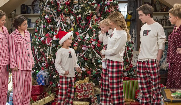 families gather around christmas tree on fuller house