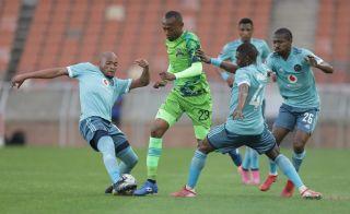 Thabo Mnyamane is challenged by Goodman Mosele
