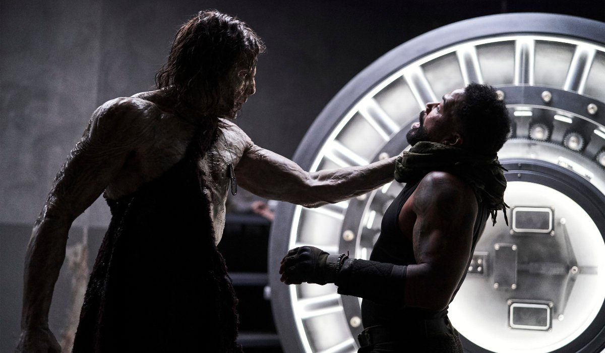 Richard Cetrone holds Omari Hardwick in the air by his throat in Army of the Dead.